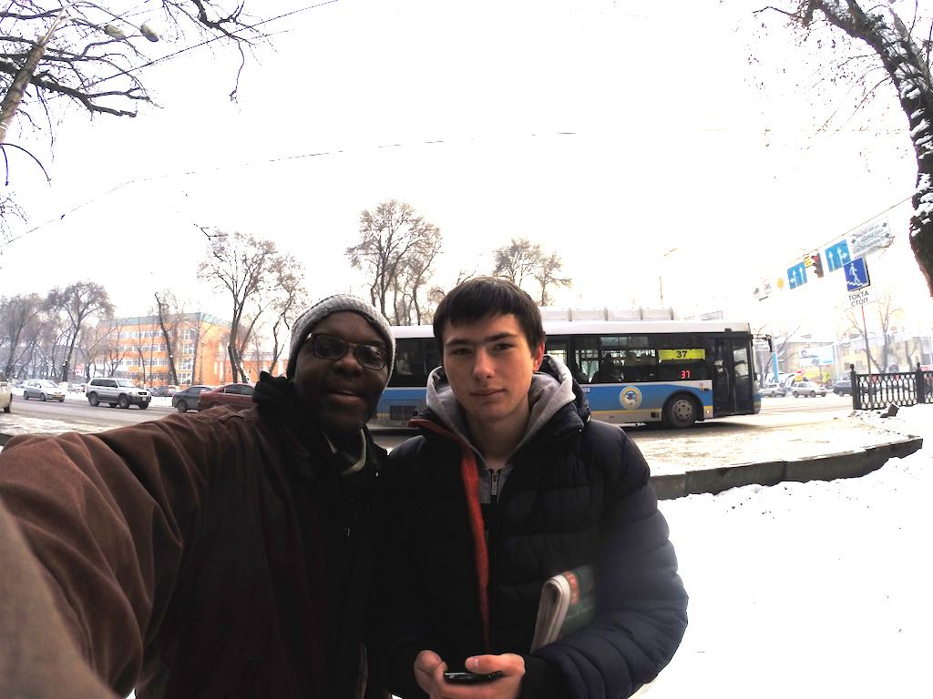 Life in Almaty, Kazahkstan. Posing with a young man from Russia who is handing out flyers on the street corner