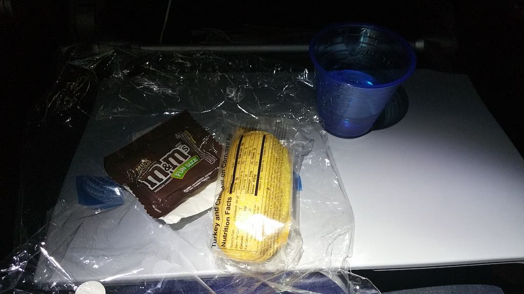 United 1: Snack Time. With 7:47 to go, its time for a mid-flight snack. Its M&Ms plus a turkey sandwich. And some water. You could have other drinks as well.